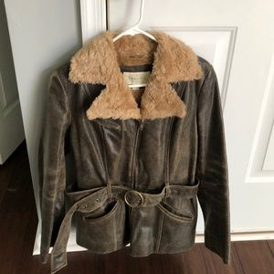 Distressed leather jacket with faux fur collar